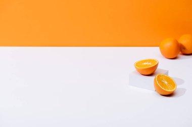 Fresh ripe oranges on white surface isolated on orange stock vector