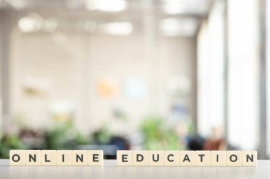 White blocks with online education lettering on white desk stock vector