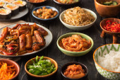 selective focus of traditional and tasty korean dishes on wooden surface
