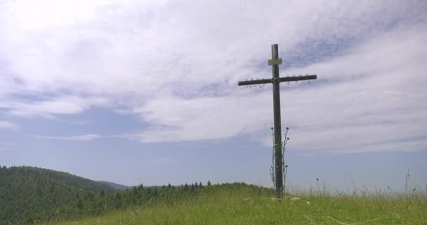 Christ cross on hill in mountain with clouds and sky