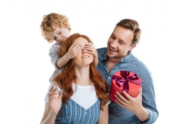 Cheerful man with adorable little son presenting gift box to happy young woman isolated on white stock vector