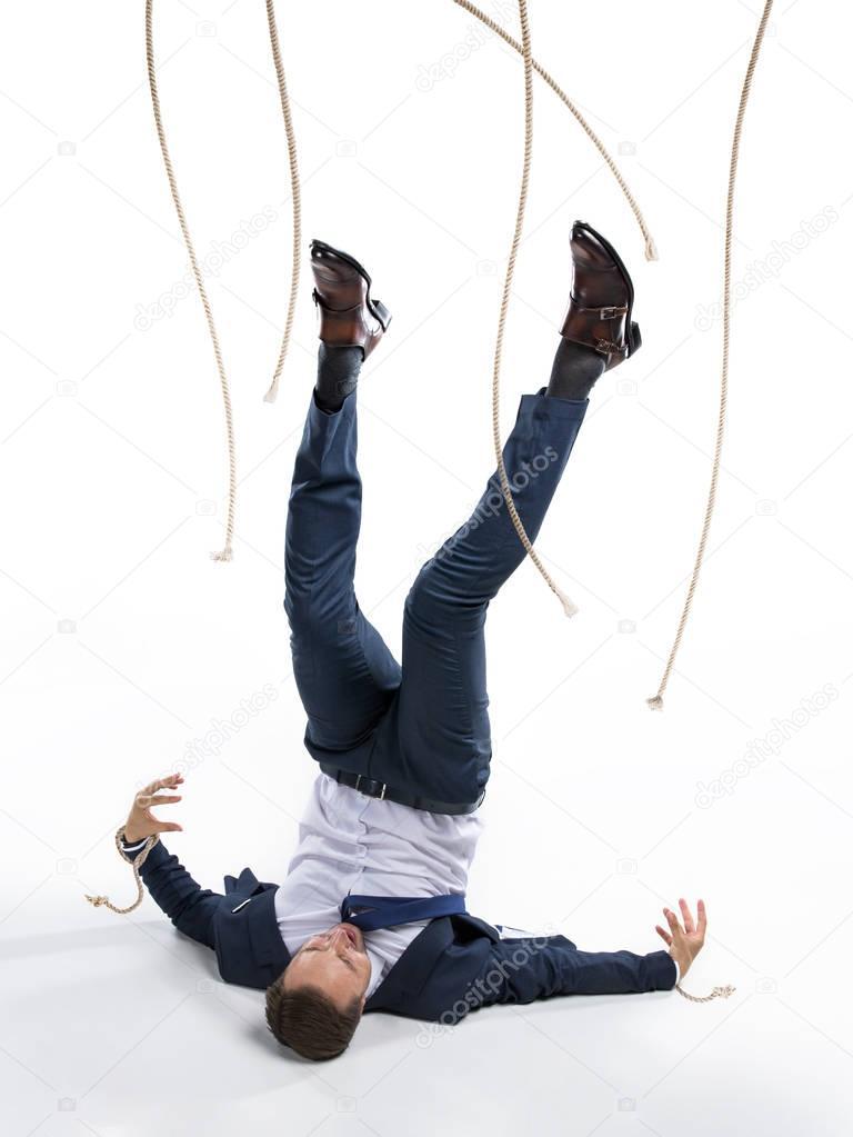 businessman and manipulating ropes
