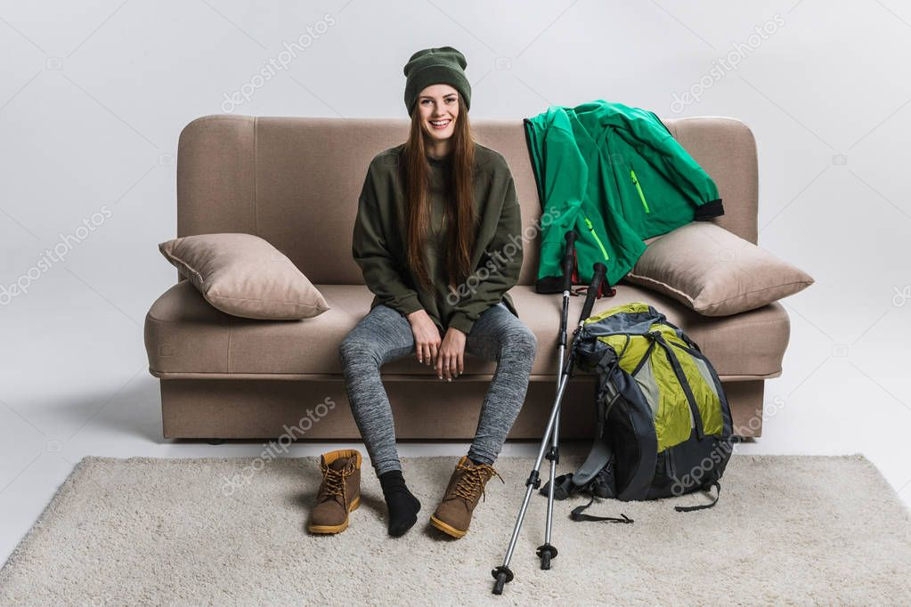 beautiful hiker wearing hiking boots and warm clothing at home