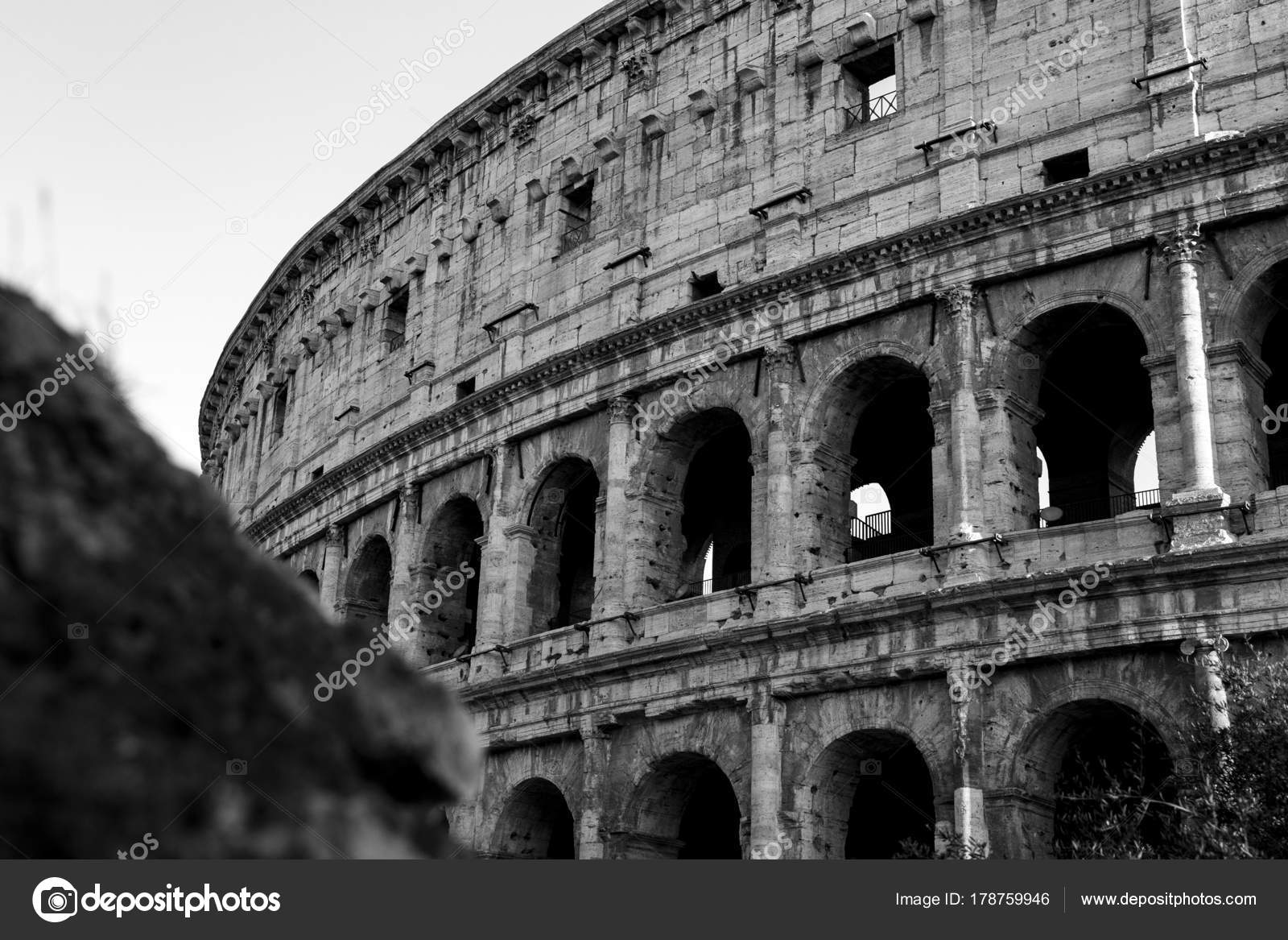 Black and white photo of the part of the wall of colosseum coliseum in rome italy at sunset stock image
