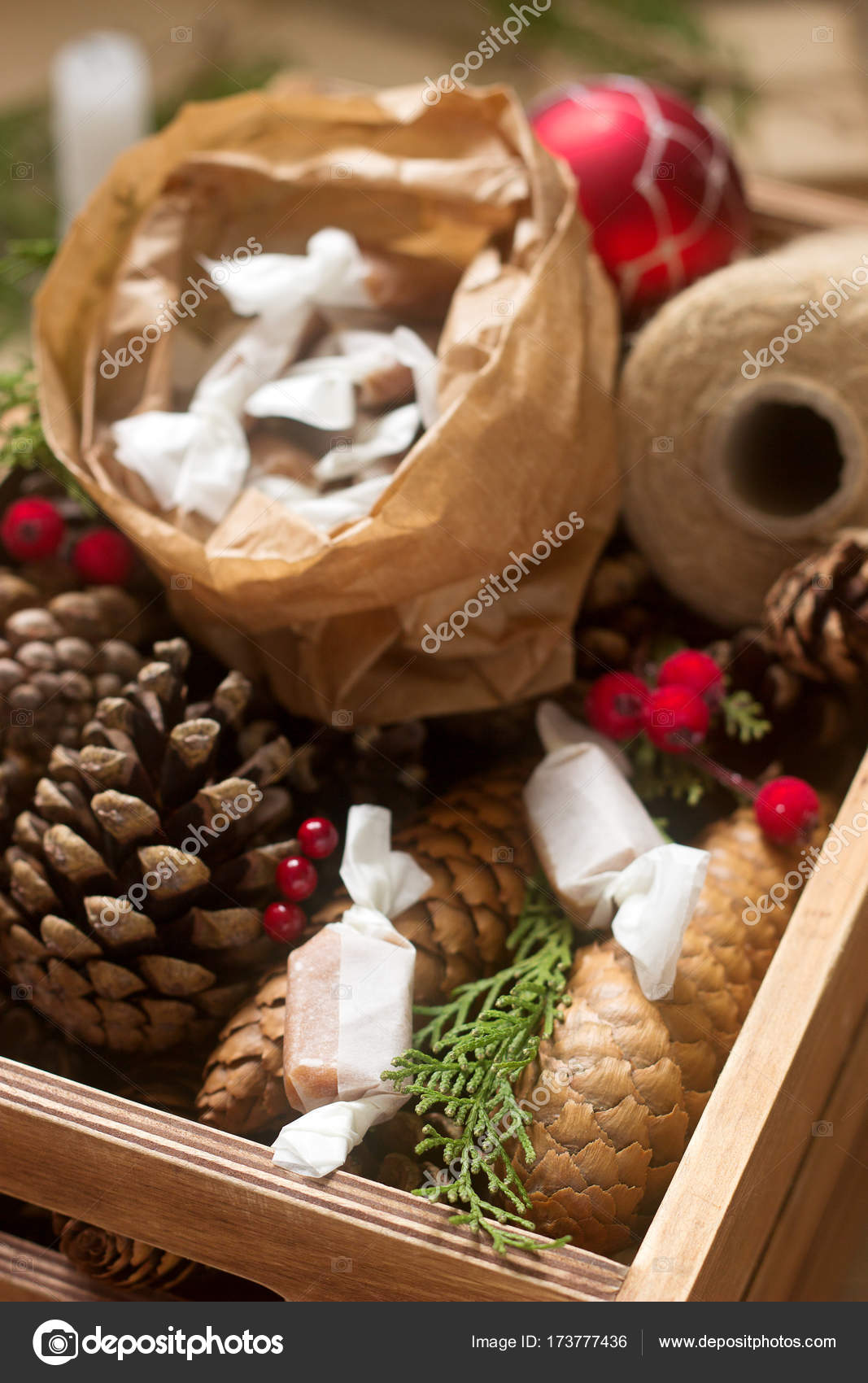 Gifts and homemade toffee in Christmas decorations. Rustic style. — Stock Photo