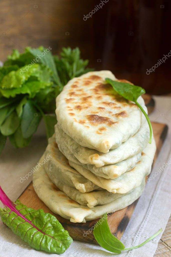 Baker making traditional dish of Armenians from Artsakh Zhingyalov hats is a type of flatbread stuffed with herbs.