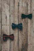Photo classic bow ties on wooden tabletop