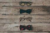 Photo stylish eyeglasses and bow ties