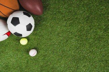 balls on grass pitch