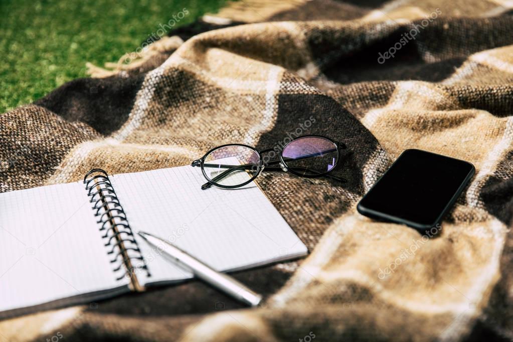 blank notebook on blanket