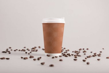 disposable cup with coffee grains