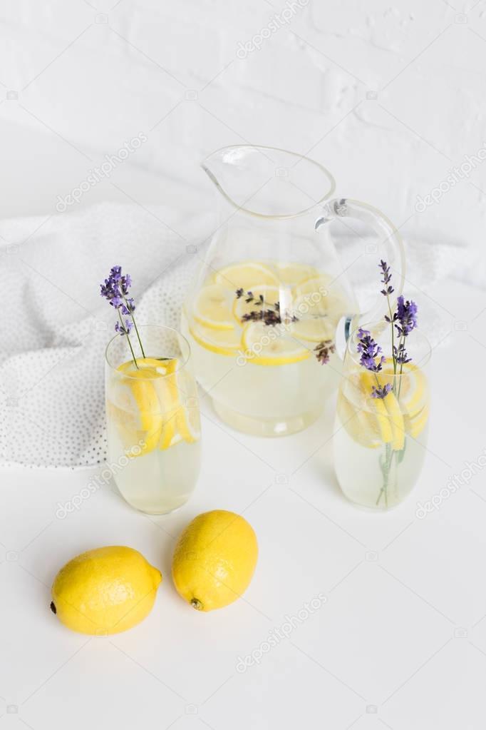 lemonade in glasses and jar