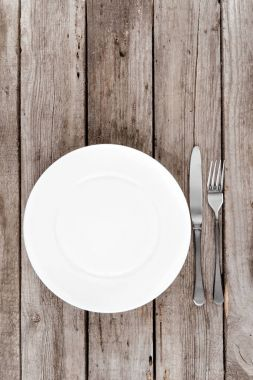 empty plate and silverware on table