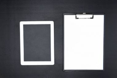 digital tablet and clipboard
