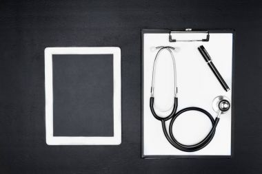 tablet, clipboard and stethoscope