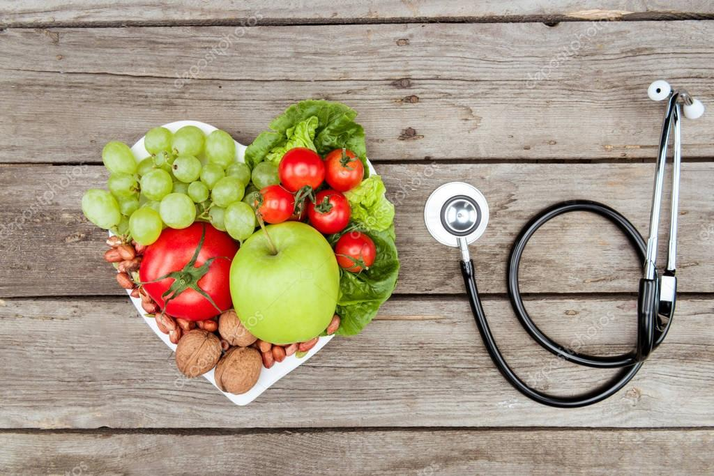 fresh vegetables, fruits and stethoscope