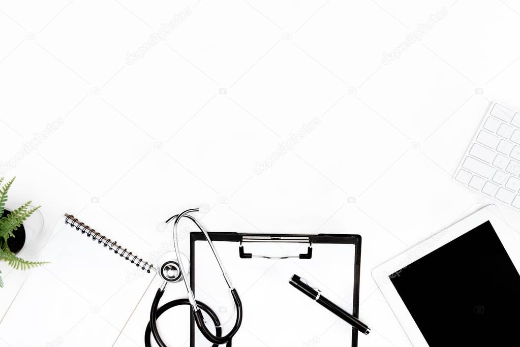 stethoscope, clipboard and digital devices