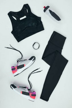 sportswear with sneakers and bottle