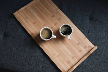 coffee on wooden tray