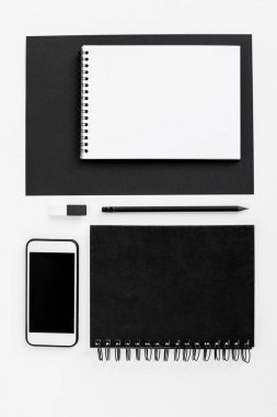 Smartphone with blank screen, notepads, coffee cup and office supplies, isolated on white stock vector