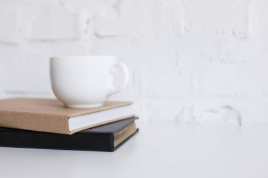 cup of coffee on books