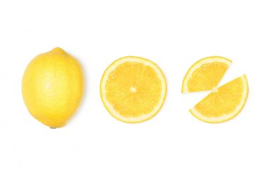 Fresh lemon with slices isolated on white stock vector