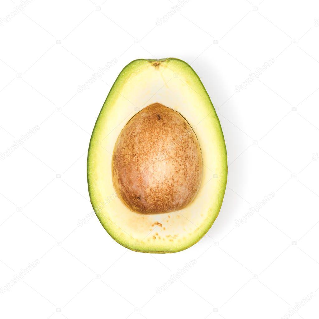 half of fresh avocado with seed