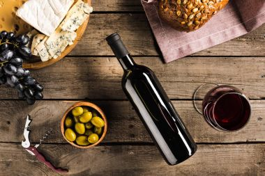 wine, bread, olives and cheese