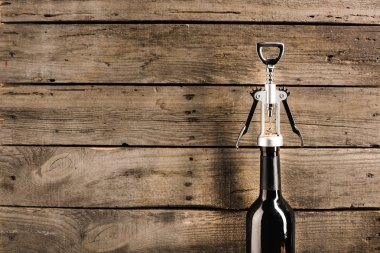 bottle of red wine and corkscrew