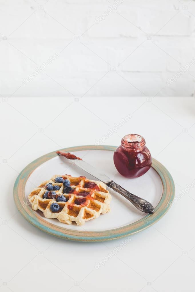 waffle with jam on plate