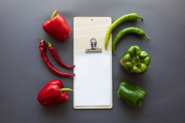 peppers and blank paper sheet