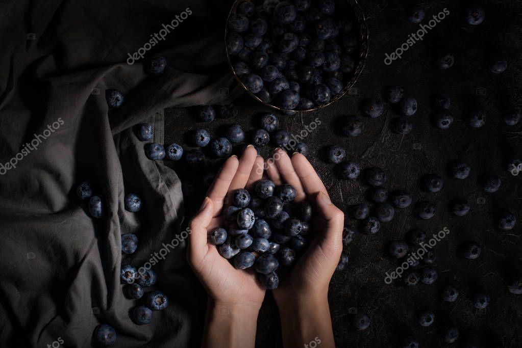 fresh blueberries in hands
