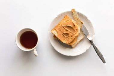 toasts with peanut butter and tea