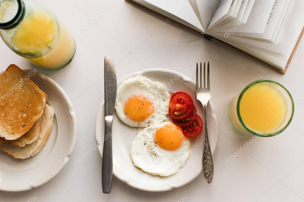 breakfast with fried eggs and juice