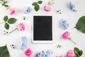 flowers and digital tablet