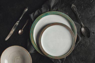 ceramic plates and silverware