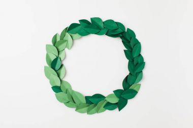 round frame of green paper leaves