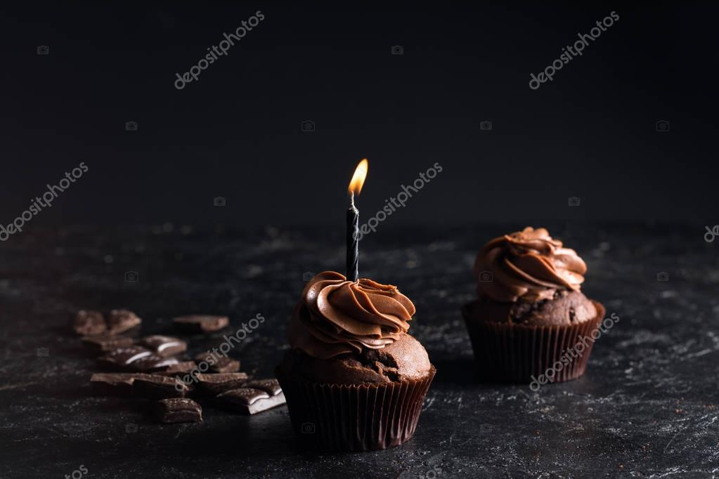 chocolate cupcake with candle