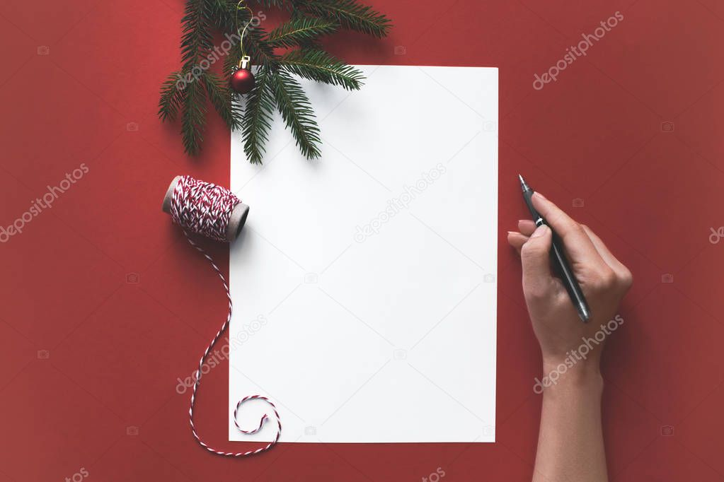 person writing christmas letter