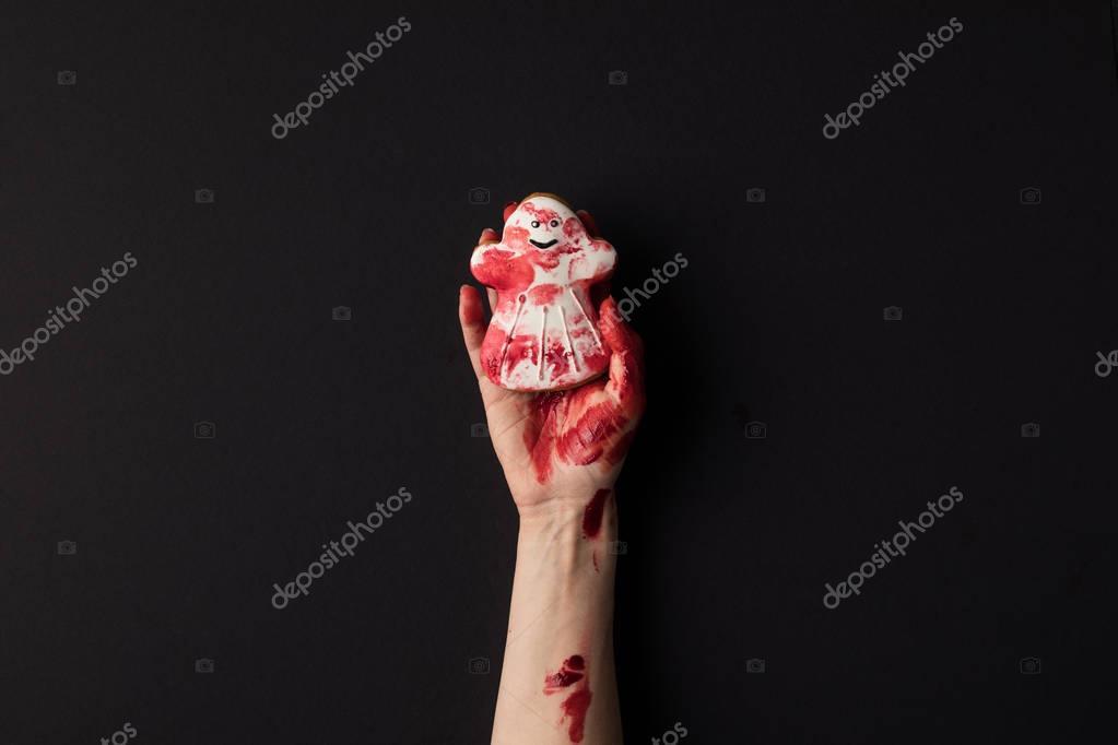 hand holding halloween cookie