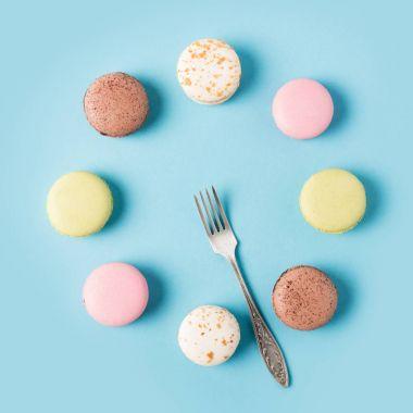 sweet macarons and fork