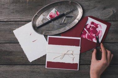 woman preparing holiday invitations