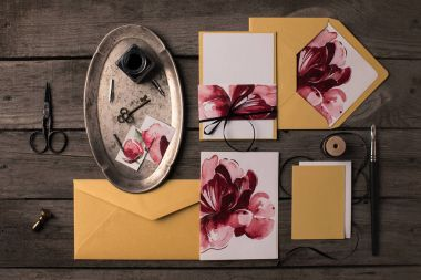 Holiday invitations with floral illustrations