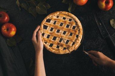 woman taking piece of apple pie
