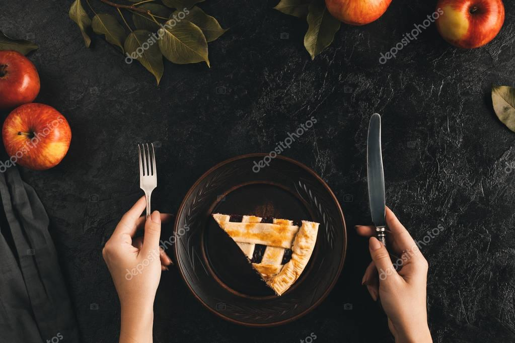 female hands and apple pie