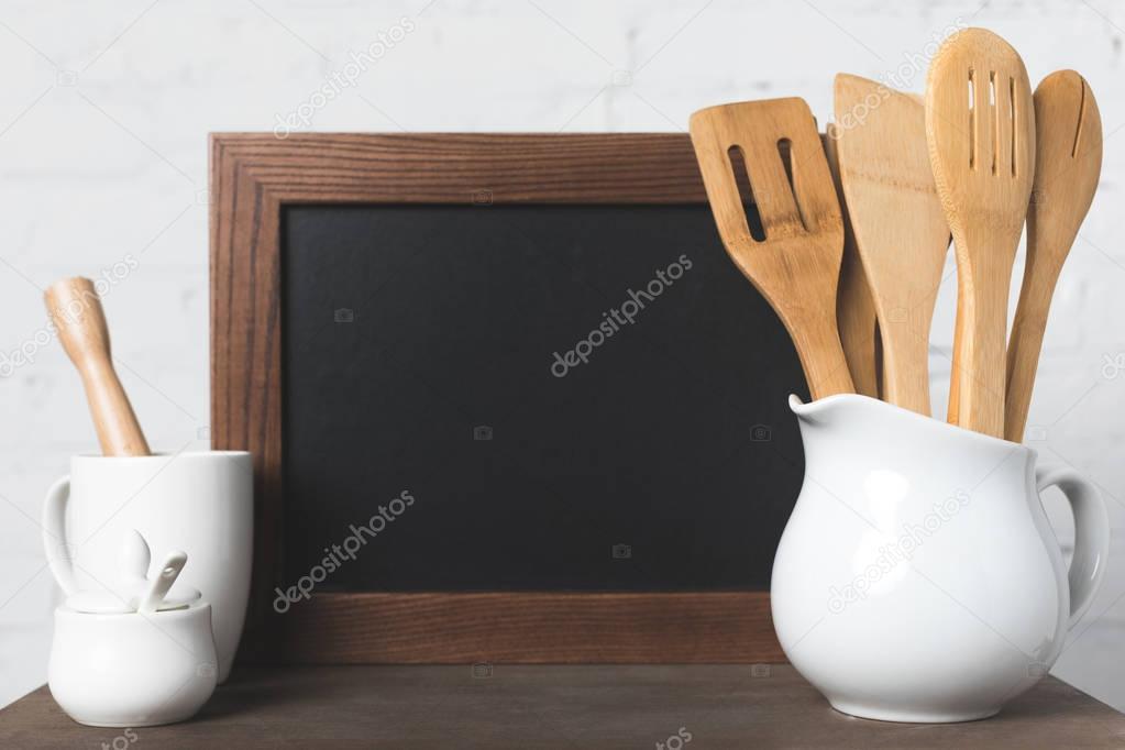 blank board and kitchen utensils