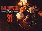 halloween cupcakes and burning candles