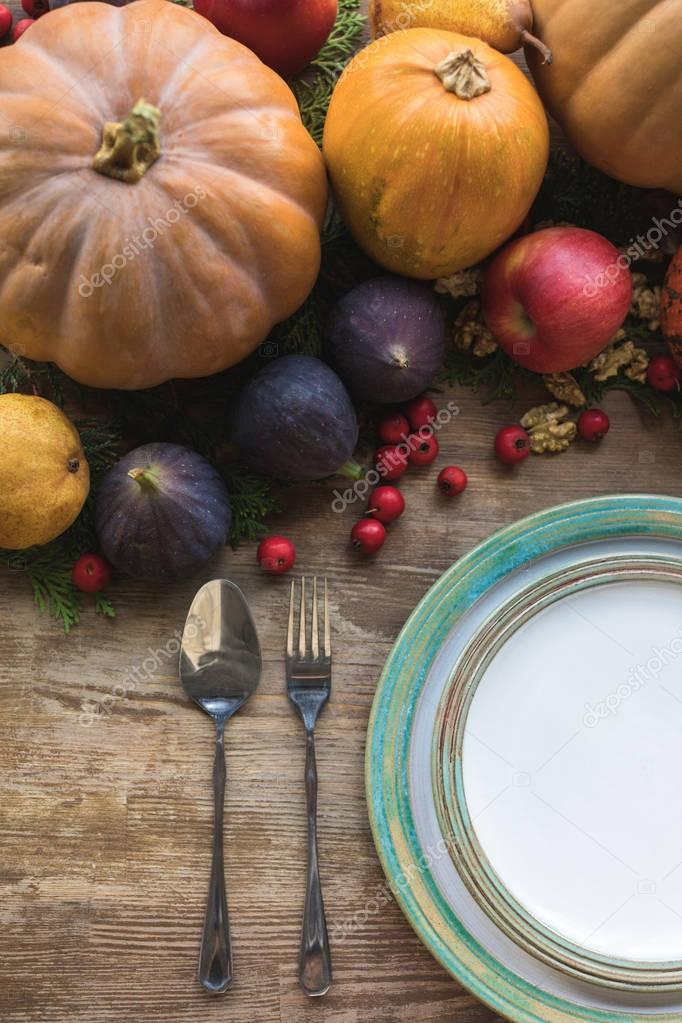 cutlery and autumn fruits
