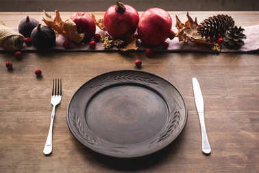 Cutlery and ripe fruits