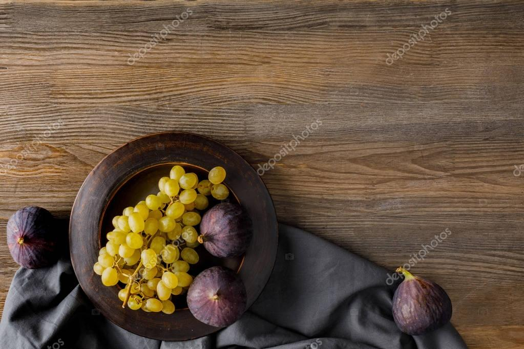 figs and grapes on plate